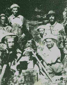 Paraguayan soldiers manning a Vickers machine gun.